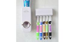 Dispensador automático de pasta de dientes y soporte para cepillos